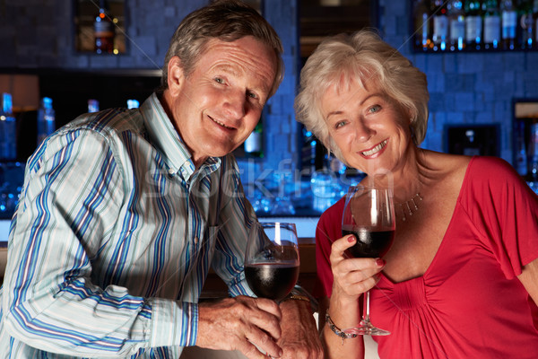 Senior Couple Enjoying Drink In Bar Stock photo © monkey_business