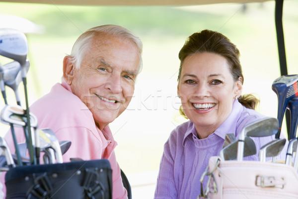 Couple Enjoying A Game Of Golf Stock photo © monkey_business