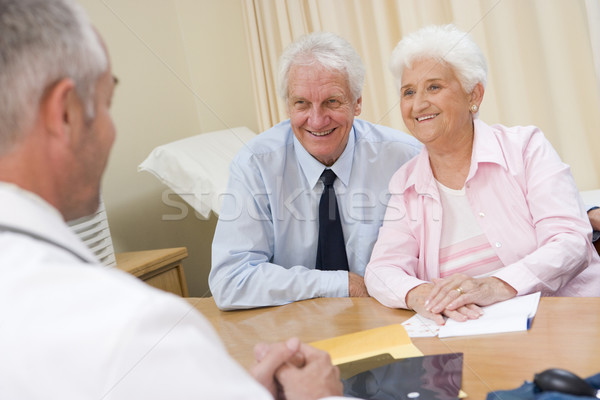 Couple in doctor's office smiling Stock photo © monkey_business
