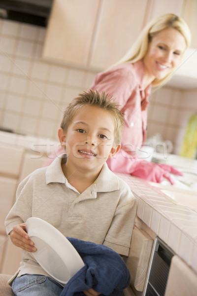 Mother And Son Cleaning Dishes Stock photo © monkey_business