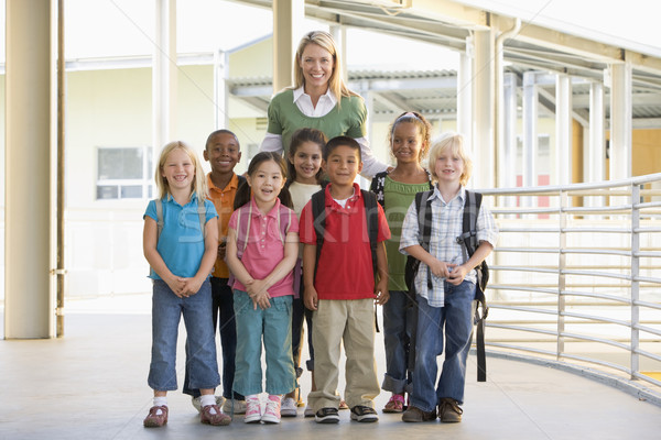 Kindergarten teacher standing with children in corridor Stock photo © monkey_business