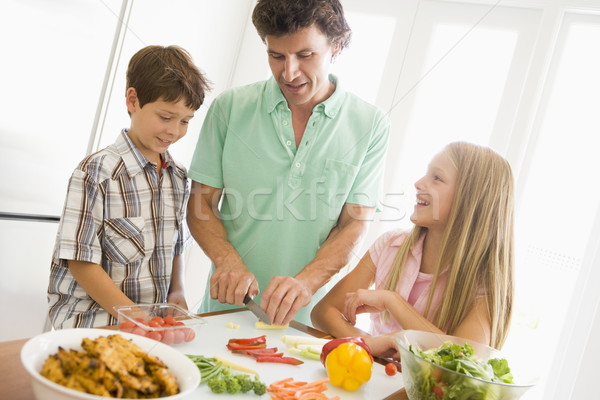 Father And Children Prepare A meal,mealtime Together  Stock photo © monkey_business