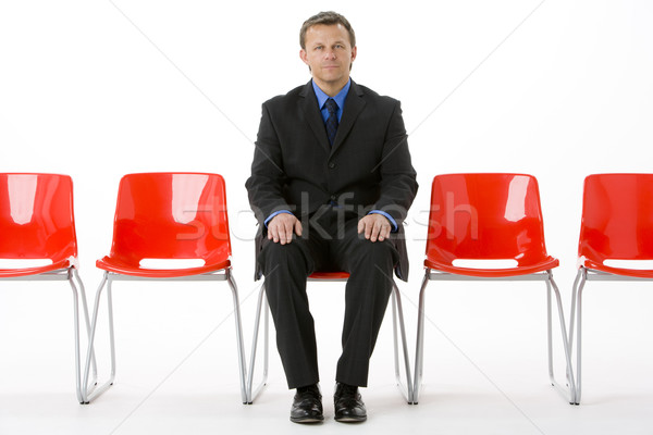 Zakenman vergadering rij lege stoelen business Stockfoto © monkey_business