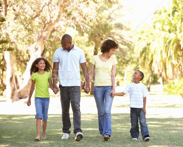 Portrait of Happy Family Walking In Park Stock photo © monkey_business