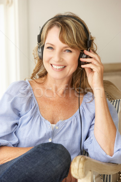Mid age woman wearing headphones Stock photo © monkey_business