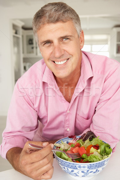 Mid age man eating salad Stock photo © monkey_business