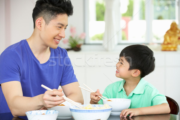Chinese Father And Son Sitting At Home Eating A Meal Stock photo © monkey_business