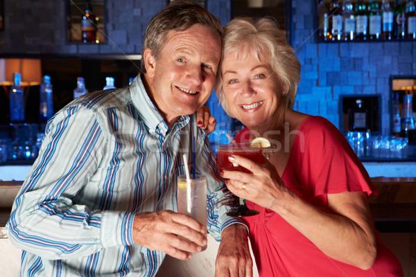 Idős pár élvezi koktél bár üveg ital Stock fotó © monkey_business