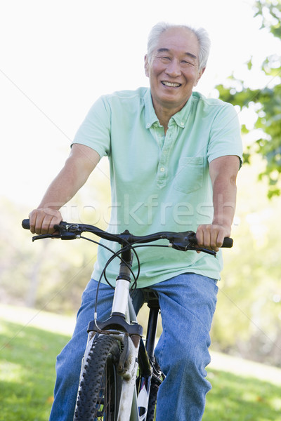 Man on bike outdoors smiling Stock photo © monkey_business