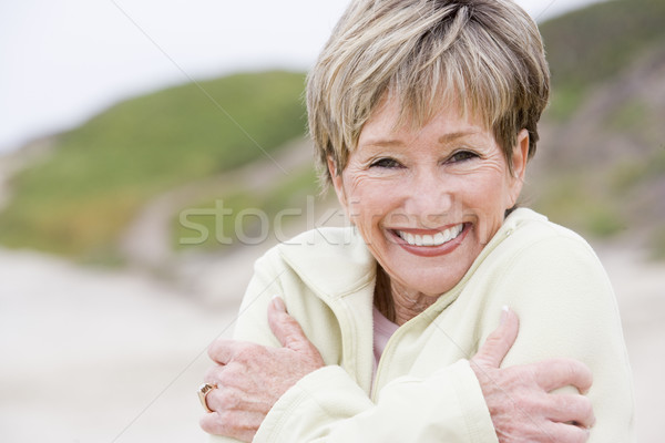 Woman at the beach cold and smiling Stock photo © monkey_business