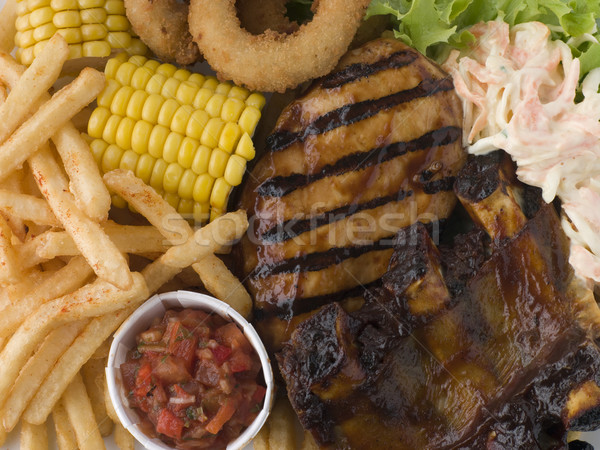Churrasco frango costelas fries salsa peito Foto stock © monkey_business