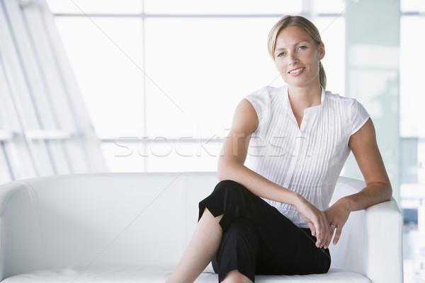 Kobieta interesu posiedzenia biuro lobby uśmiechnięty działalności Zdjęcia stock © monkey_business