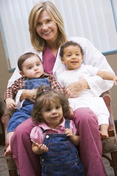 Berater drei Kleinkinder halten Frau Baby Stock foto © monkey_business