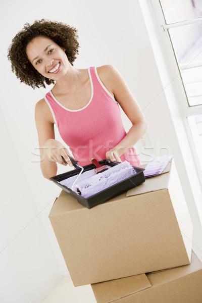 Mujer pintura nuevo hogar mujer sonriente sonriendo casa Foto stock © monkey_business