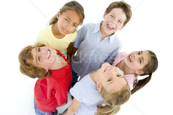 Cerchio cinque giovani amici sorridere sorriso Foto d'archivio © monkey_business