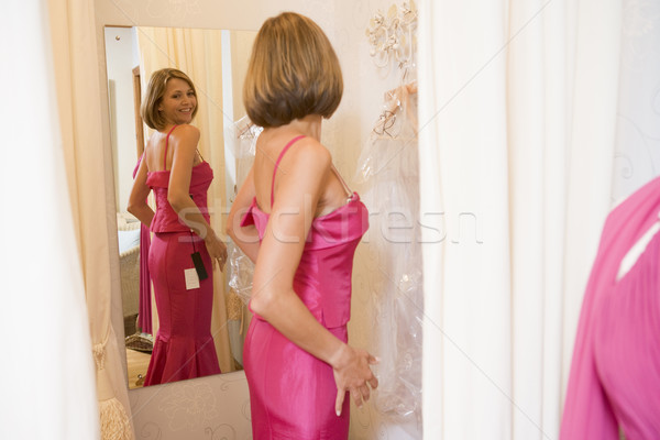 Woman trying on dresses and smiling Stock photo © monkey_business