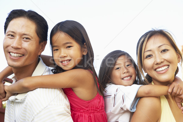 Young Family Playing In Garden Together Stock photo © monkey_business