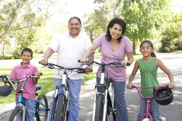 Grands-parents parc petits enfants équitation vélos fille Photo stock © monkey_business