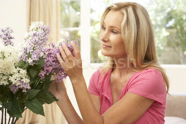 Woman At Home Arranging Flowers Stock photo © monkey_business