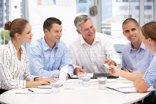 Uomini d'affari riunione business computer ufficio donne Foto d'archivio © monkey_business