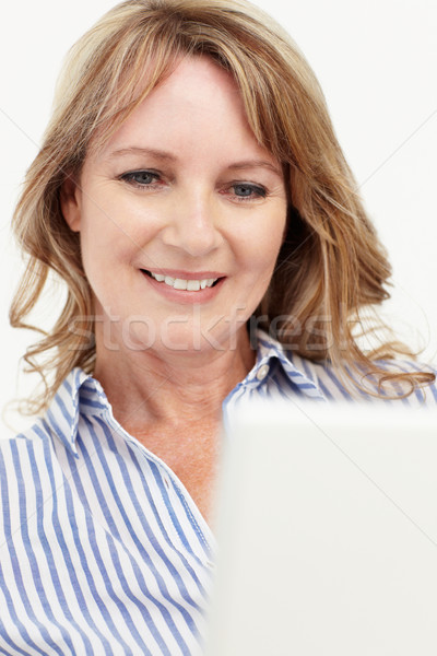 Mid age businesswoman using laptop Stock photo © monkey_business