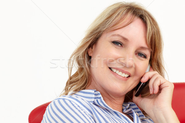 Stock photo: Mid age businesswoman using cellphone