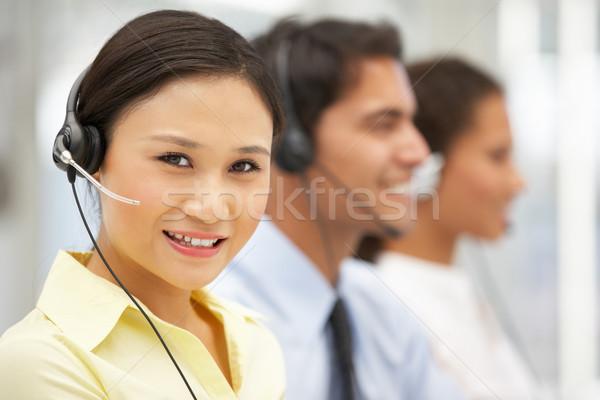 Empresária fone negócio mulher trabalhar Foto stock © monkey_business