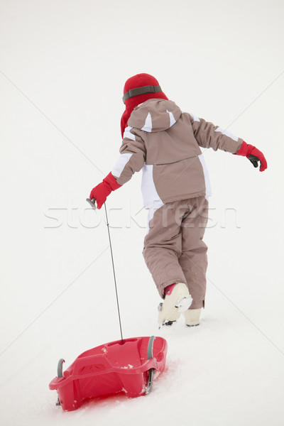 Back View Young Girl Pulling Sledge On Ski Holiday In Mountains Stock photo © monkey_business