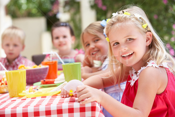 Group Of Children Enjoying Outdoor Tea Party Stock photo © monkey_business