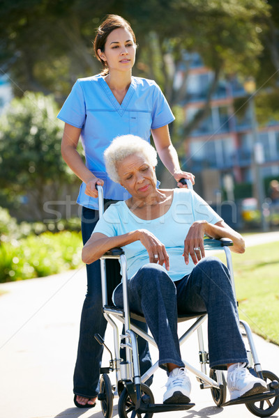 Gondozó toló boldogtalan idős nő tolószék Stock fotó © monkey_business