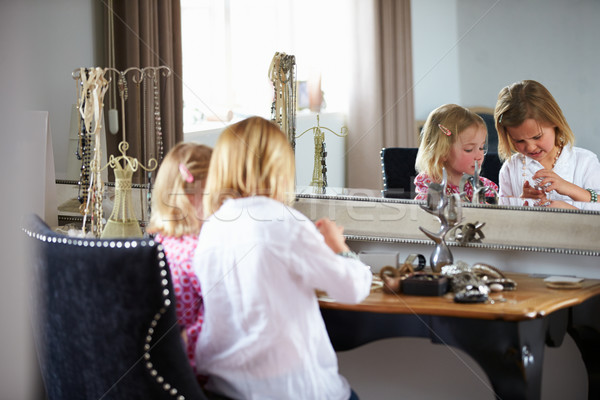 Two Girls Playing With Jewelry And Make Up Stock photo © monkey_business