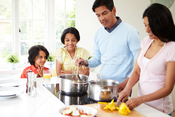 Indian Family Cooking Meal At Home Stock photo © monkey_business