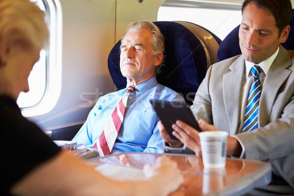 üzletember pihen vonat utazás nők technológia Stock fotó © monkey_business