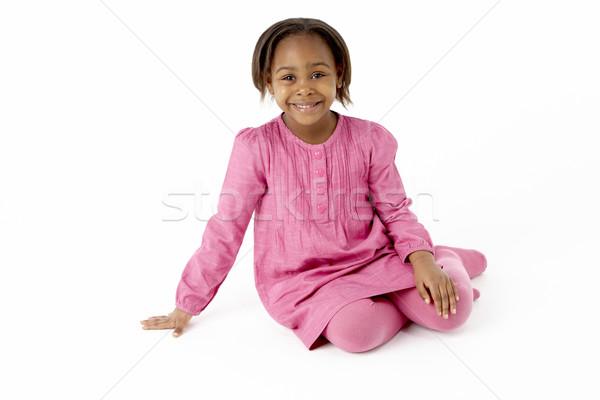 Giovane ragazza seduta studio ragazza bambini felice Foto d'archivio © monkey_business