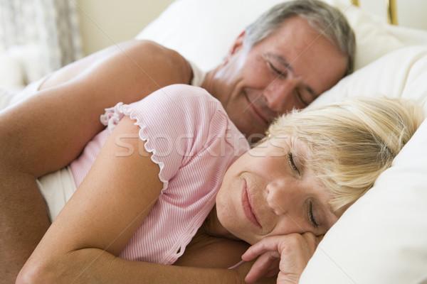Couple lying in bed sleeping Stock photo © monkey_business