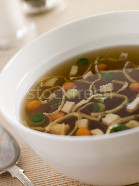 Chicken Consomm with Vegetable Pearls and Julienne of Pancake Stock photo © monkey_business