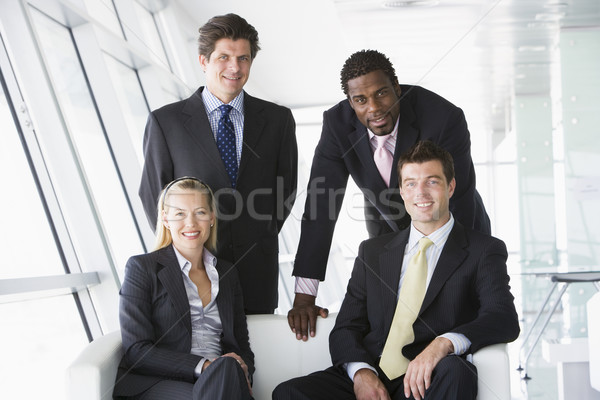 Quatre gens d'affaires bureau lobby souriant affaires Photo stock © monkey_business