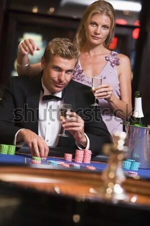 Man with glamorous women in casino Stock photo © monkey_business