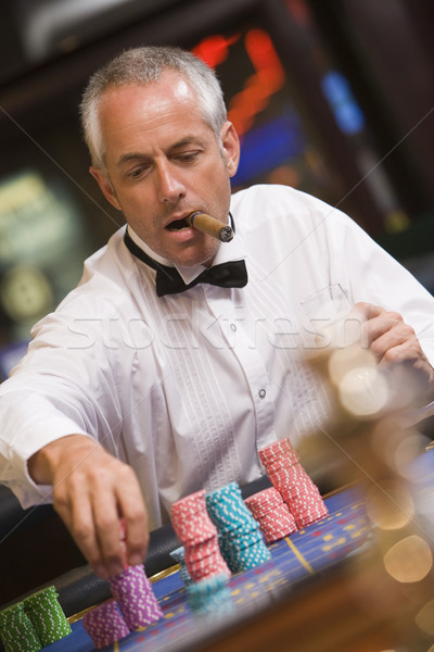 Man placing bet at roulette table Stock photo © monkey_business