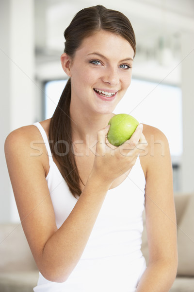 Young Woman Eating An Apple Stock photo © monkey_business