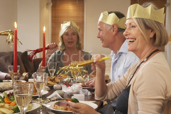 Friends Wearing Party Hats At A Dinner Party Stock photo © monkey_business