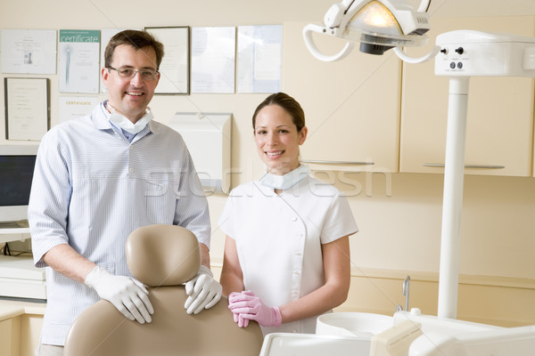 Dentist and assistant in exam room smiling Stock photo © monkey_business