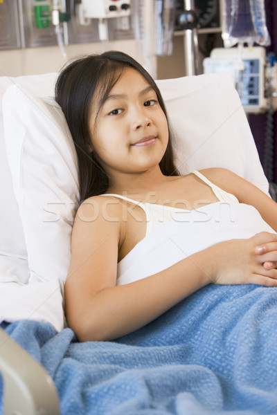 Stock photo: Young Girl Lying In Hospital Bed