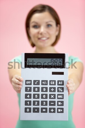 Young Girl Holding Calculator Stock photo © monkey_business