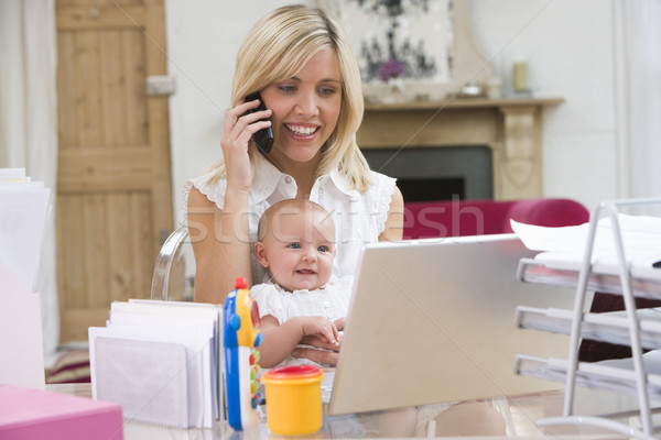 Stock photo: Mother and baby in home office with laptop and telephone