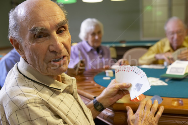 Senior adults playing bridge Stock photo © monkey_business