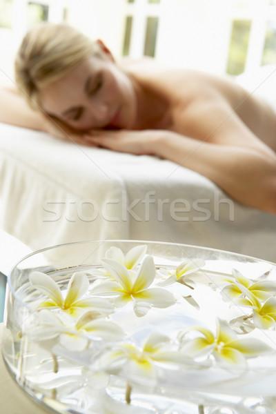 женщину массаж таблице цветы передний план молодые Сток-фото © monkey_business
