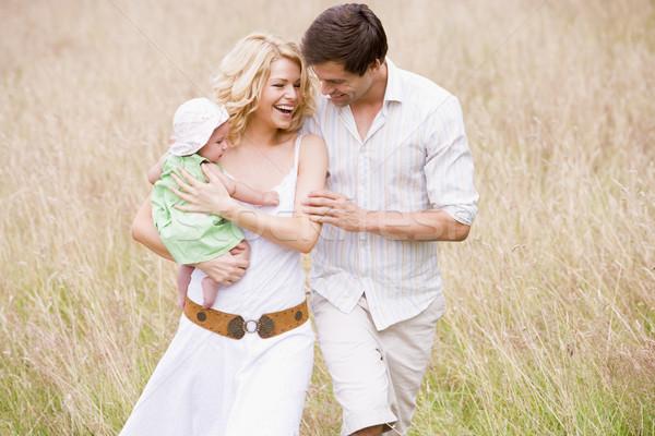 Stock photo: Family walking outdoors smiling