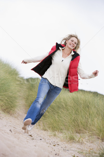Stock photo: Woman running at beach smiling