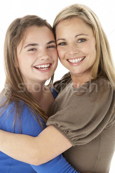 Studio Portrait Of Mother Hugging Daughter Stock photo © monkey_business